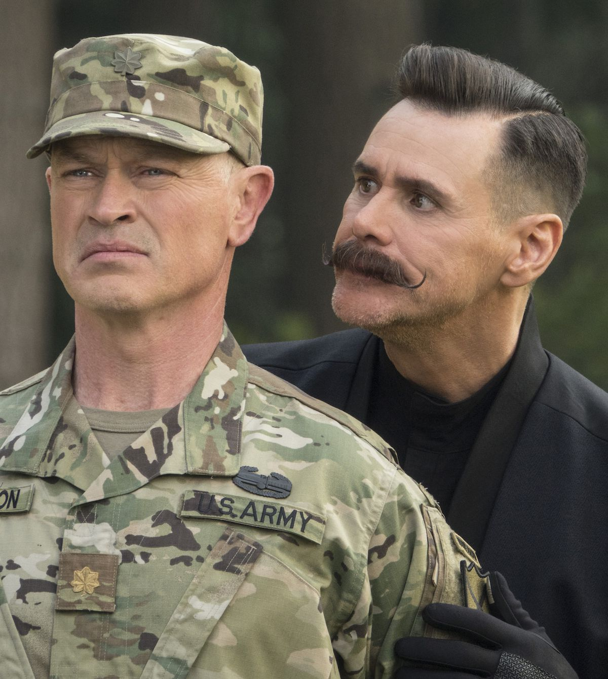 Dr. Robotnik (Jim Carrey) annoys Army officer (Neal McDonough) in Sonic the Hedgehog