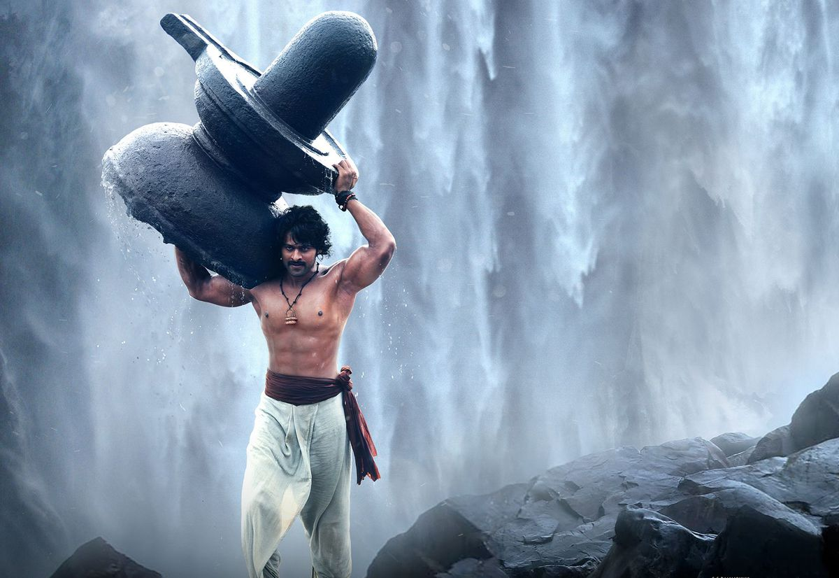 Baahubali: The Beginning - prabhas as baahubali carrying a giant fountain