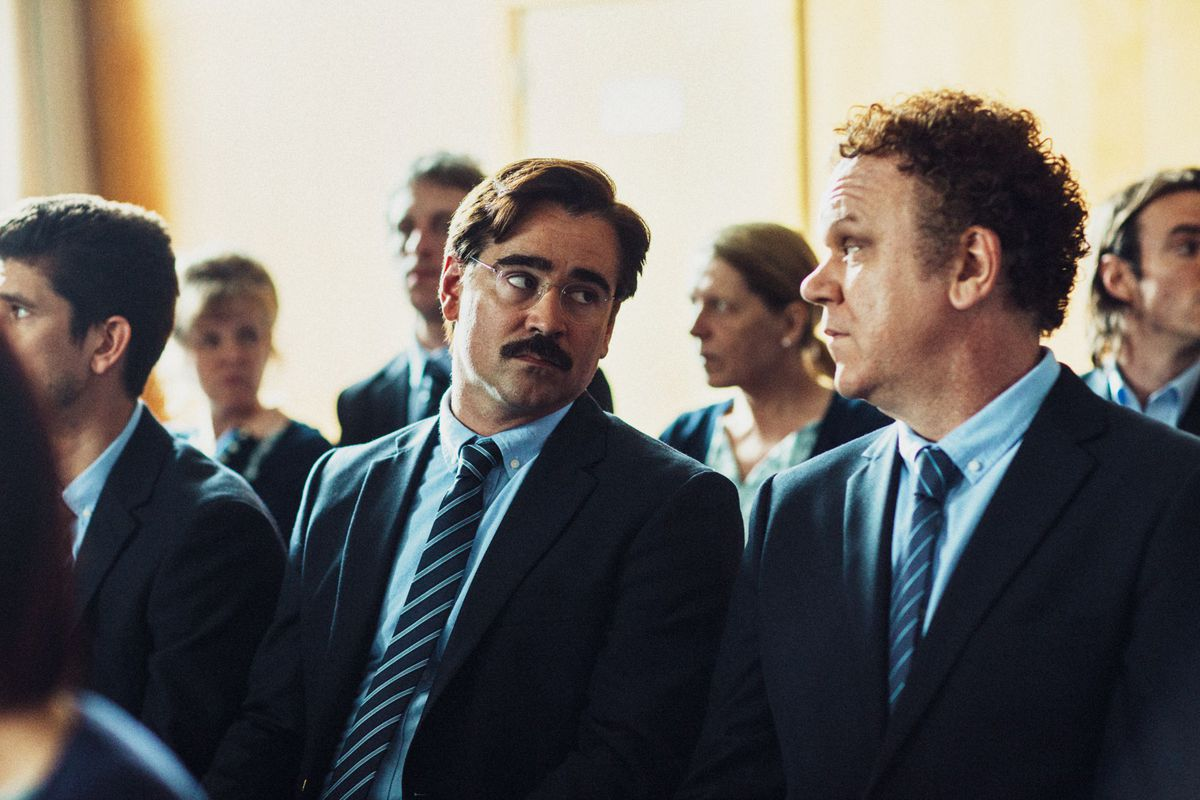 Colin Farrell and John C. Reilly seated side by side in The Lobster.