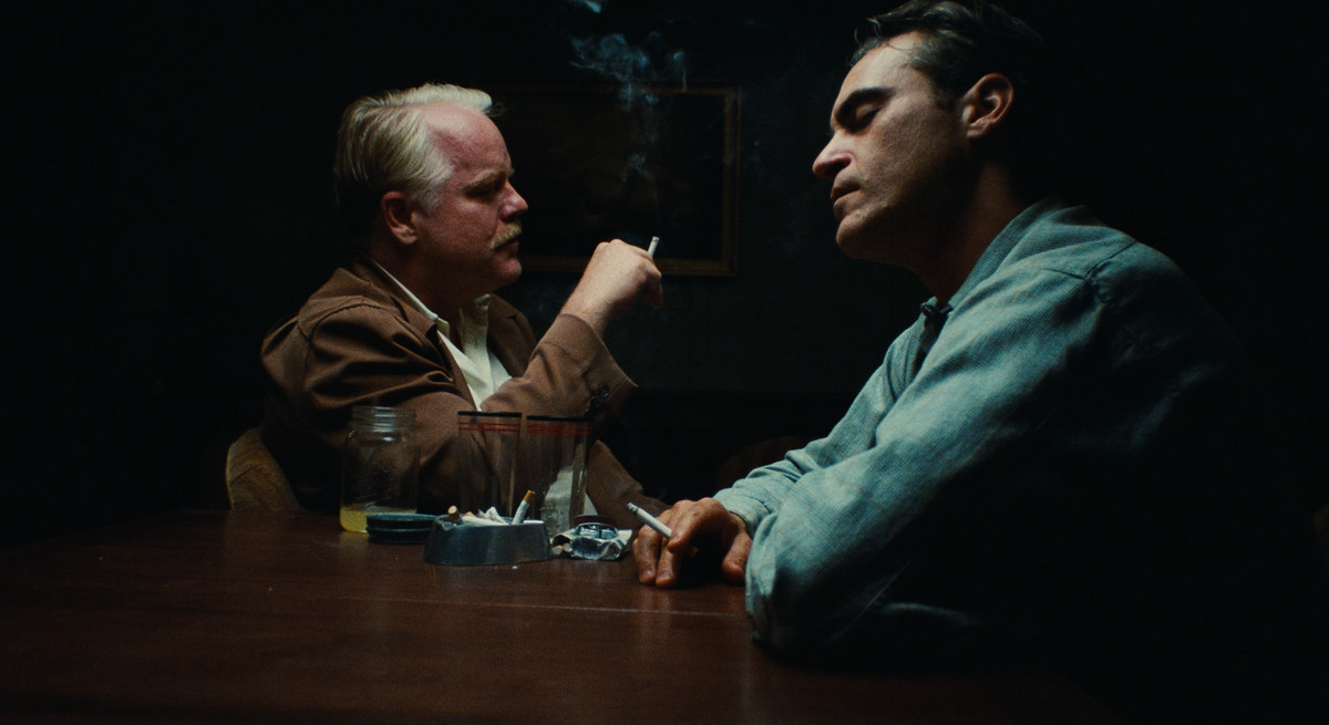 Lancaster Dodd (Philip Seymour Hoffman) processes Freddie Quell (Joaquin Phoenix) while smoking a cigarette in a key scene from The Master