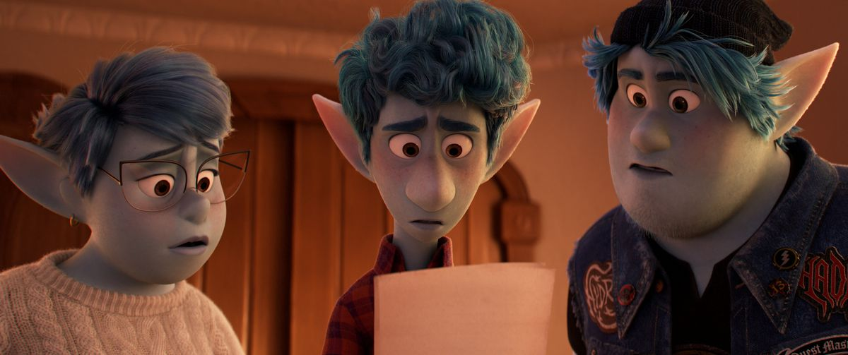 Blue elves Barley, Ian, and their mother all gape at a written message Ian is holding in Pixar's Onward.
