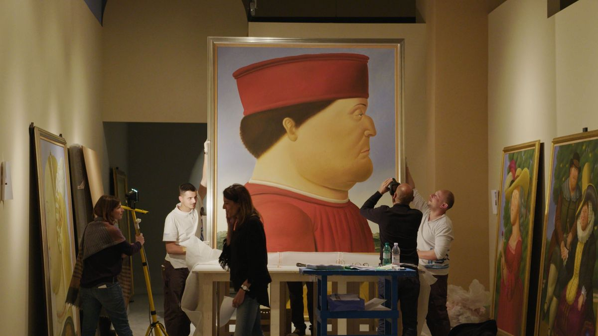 people gathered around a botero painting