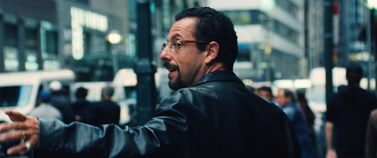 Adam Sandler sporting a leather jacket.