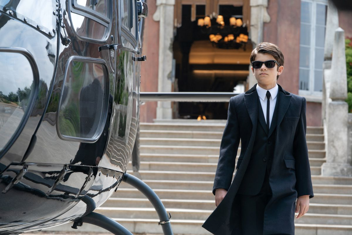 Ferdia Shaw is Artemis Fowl in Disney's ARTEMIS FOWL, walking with his cool sunglasses
