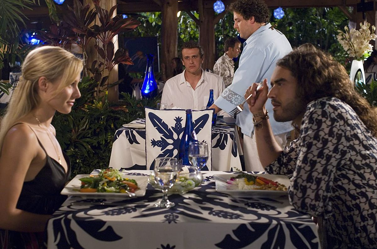 Peter (Jason Segel) watches Sarah (Kristen Bell) and Aldous (Russell Brand) on a date