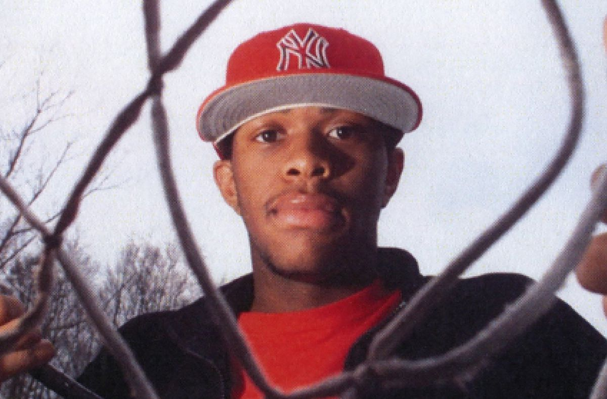 Lenny Cooke looks through a basketball net