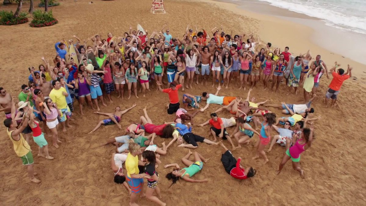 The cast of Teen Beach Movie in the middle of a dance number