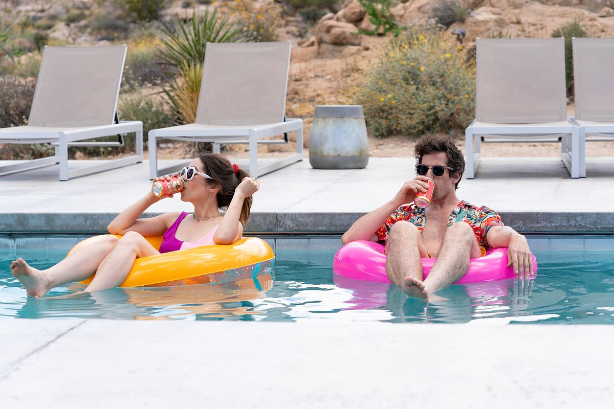 two people on pool floats