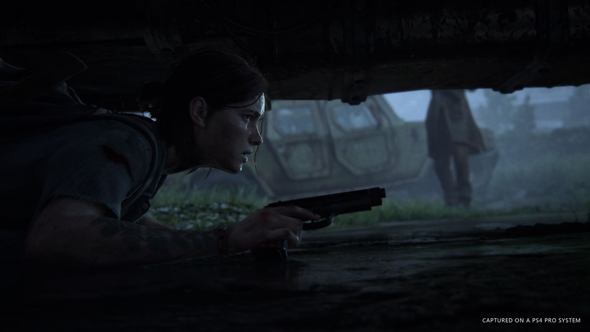 Ellie hides under a car in The Last of Us Part 2