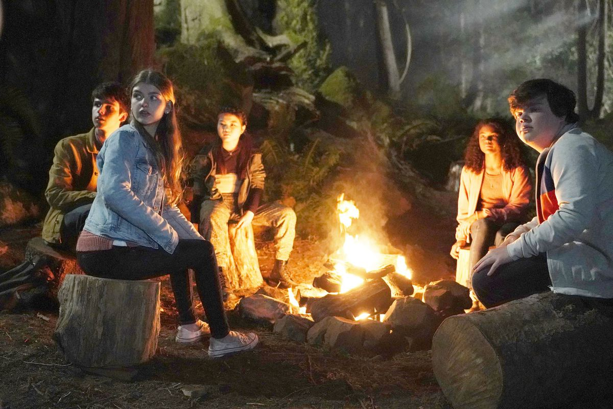 Are You Afraid of the Dark 2019: the new midnight society sits around the campfire