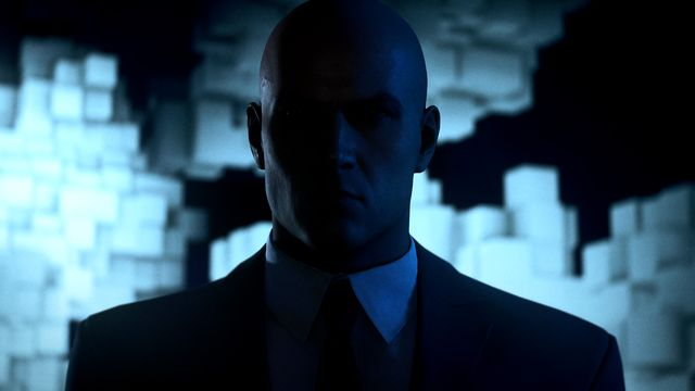 a close-up of Agent 47, with glowing blocks behind him, in Dubai in Hitman 3